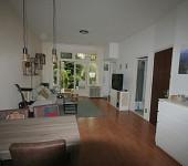 Per 1 juli ter huur zonnig appartement met tuin